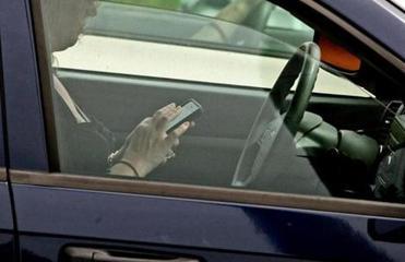 A driver checked the last entry on her device.